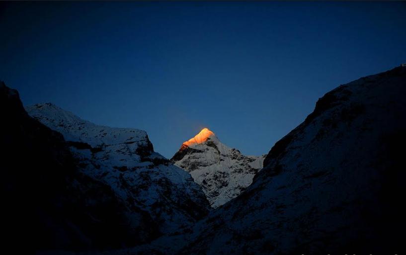 first sunrays on neelkantha peak